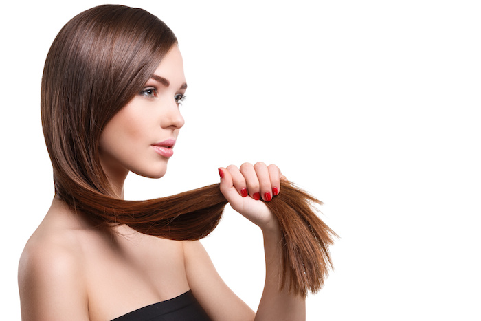 Woman with beautiful long hair on white background